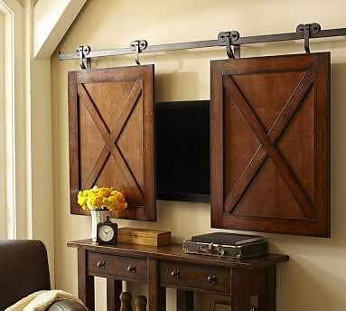 Rolling Cabinet Media Solution. I was just invisioning this the other day..I thought, why can't I have 2 barn doors to cover my flat screen as it sits in its niche?Now I have an example of how it would look.