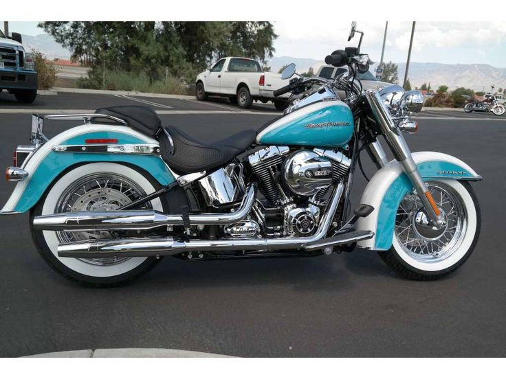 Softail Heritage. THIS is the bike I need to get! Except zero chrome. I hate chrome.