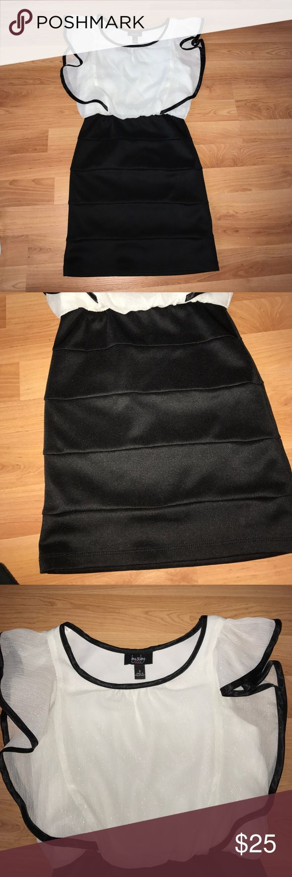 Girls black and white mini dress Gorgeous black and white girls mini dress ( I call this a big girl dress) lol black skirt with sheer and shimmery cream colored flowy top with black trim worn once girls size 8 Dresses