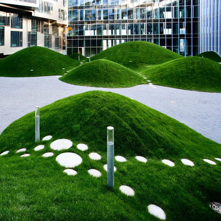 Image result for climbing wall in artificial grass mound