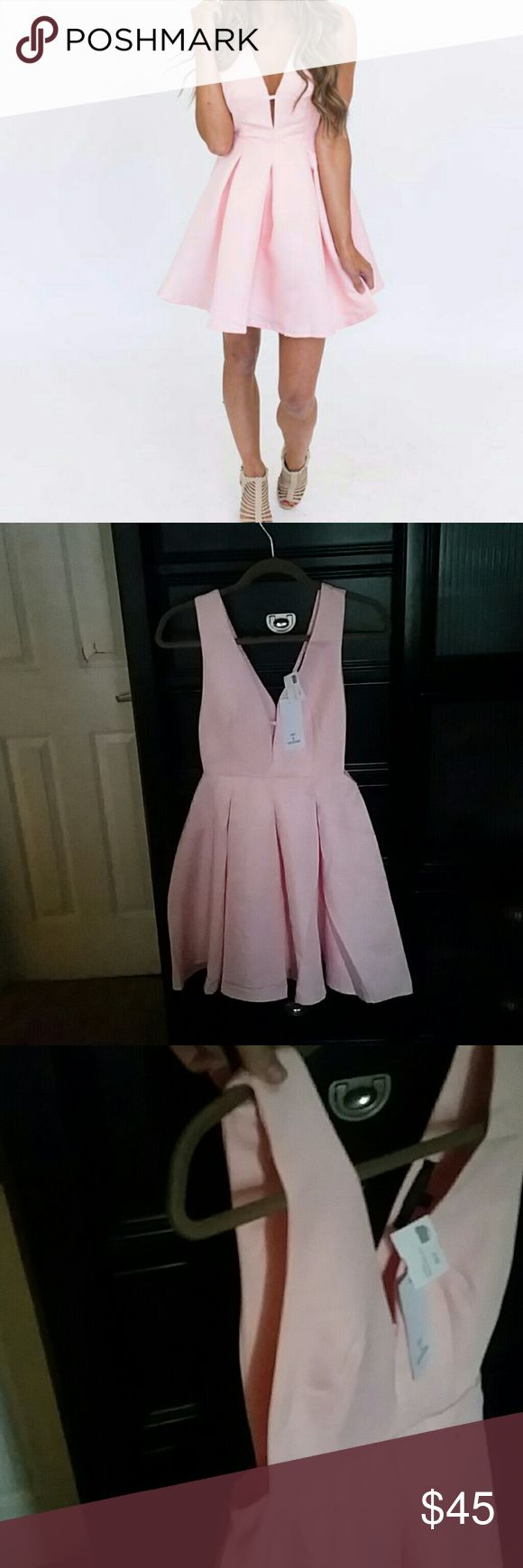Dottie Couture dress Never worn, light pink/peach Dottie Couture dress. Originally $56, no longer available on the website. I loved this dress, but it was too short on me. Open sides from underarms to waist. Dottie Couture Dresses Mini