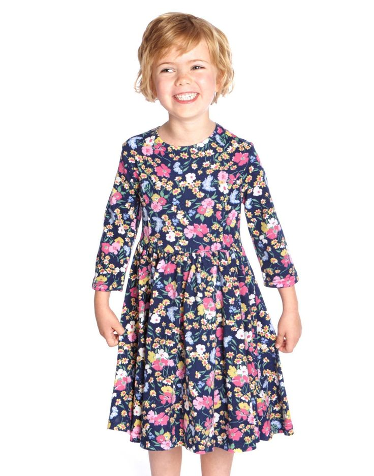 Joules Girls Three Quarter Sleeve Dress, Navy Floral.                     In a signature pretty Joules print, with three quarter length sleeves, a full skirt for twirling and crafted from heavier weight slub jersey this is the ideal dress for wearing with leggings or tights to keep out the cold.