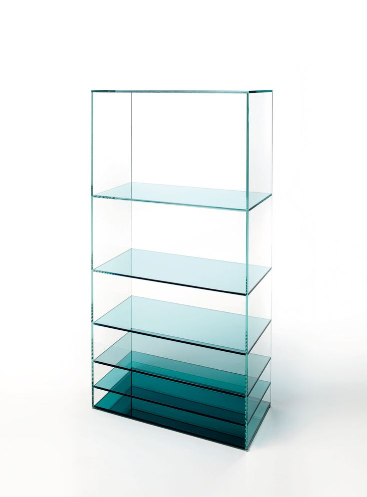 DEEP SEA design Nendo | Low tables and bookcase in laminated and thermo-welded transparent extralight glass. The shelves of the bookcase and the vertical elements of the low tables are in coloured transparent glass available in grey or blue tone. Moving from one element to the next, the distance between them gradually decreases, whilst the intensity of colour increases. This chromatic effect, associated with the mirror bases, bestows great depth to the pieces and a play of magical…