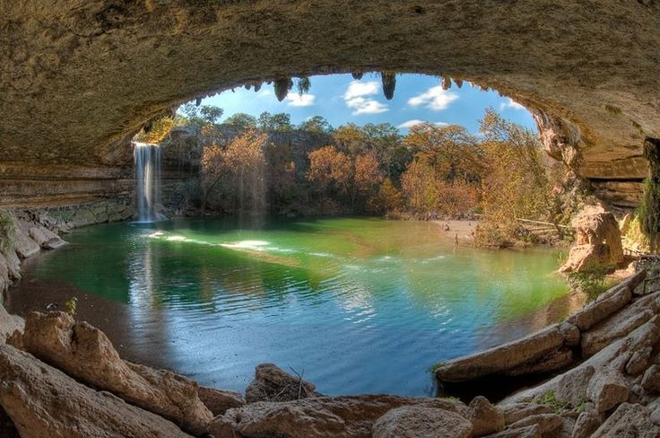 Hamilton Pool Preserve is a natural pool that was created when the dome of an underground river collapsed due to massive erosion thousands of years ago. The pool is surrounded by huge slabs of limestone that rest by the water's edge; large stalactites grow from the ceiling high above.