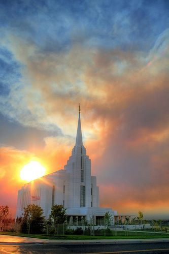 The Sun Bursting through the Clouds Behind the Rexburg Temple