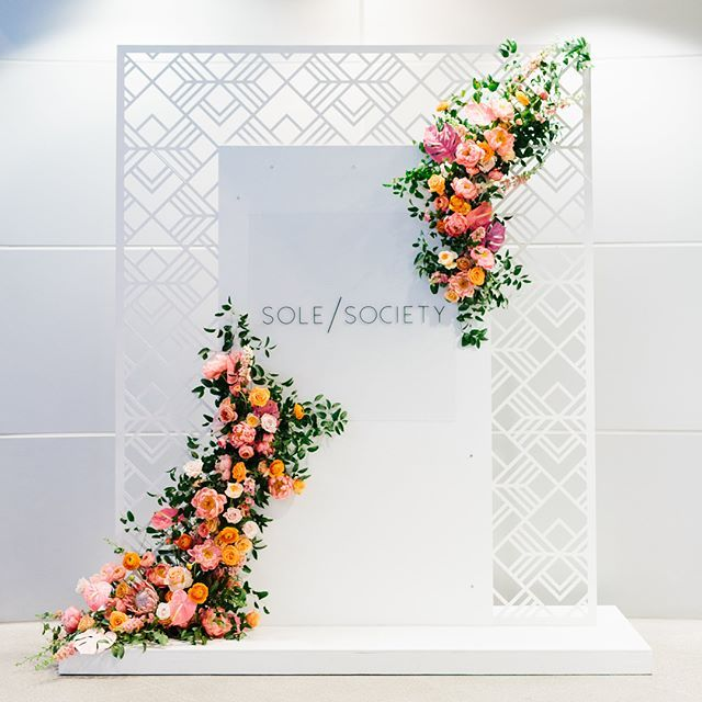 A floral Instagram photo backdrop at an event