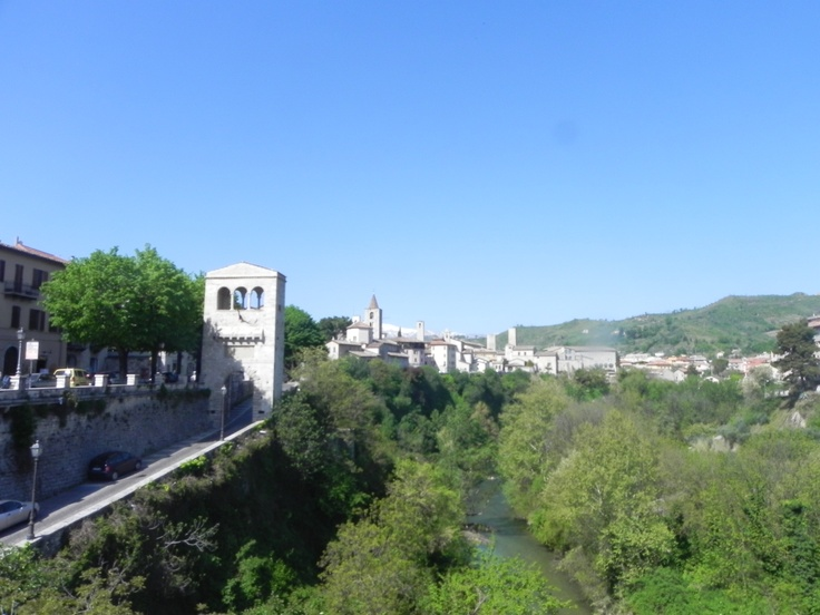 """Ascoli Piceno's Skyline from one of the 6 """"districts"""" of Ascoli: Porta Tufilla. From here you can see the Tronto River, The Vettore Mountain and a few ancient houses of downtown Ascoli. On the left the symbol of the district!"""