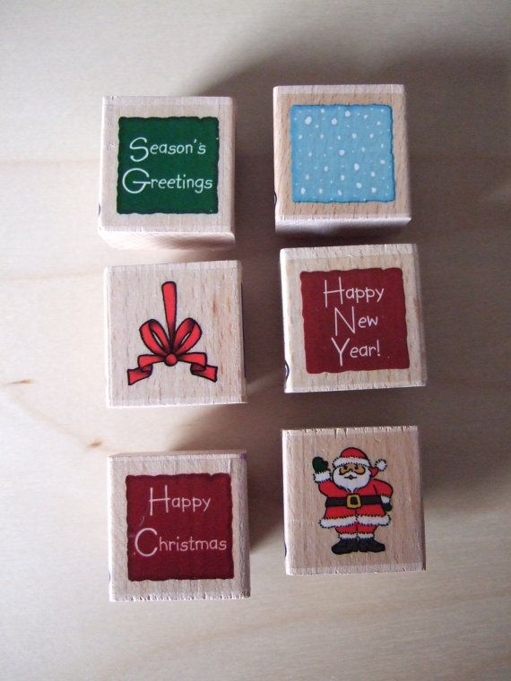 Set of 6 Christmas Rubber Stamps by Whispers. Brand New. Santa, Bow, Snow, Happy Christmas, Season's GreetingsHappy New Year