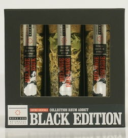 """Giftbox """"Rum Black Edition""""  Een verrassend pakket om je eigen cocktail van rum te bereiden met de varianten Zouk, Torride, Bois Bandé.  Bereiding Zouk, Torride, Bois Bandé Doe alle kruiden in een liter witte rum, voeg 2 eetlepels bruine suiker of honing, laat het geheel 1 maand staan. Ook te gebruiken als toevoeging aan een dessert."""