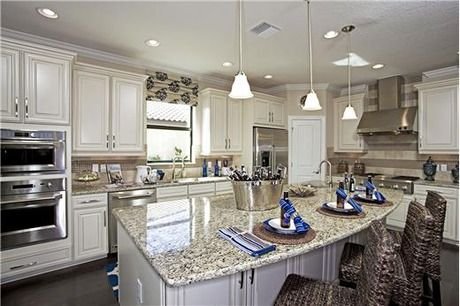 Stainless steel appliances complement white cabints. The Lazio model by Taylor Morrison at Esplanade Golf and Country Club. Lakewood Ranch, FL.