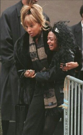 Celebrities are photographed at Aaliyah's funeral.
