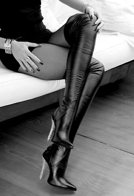 Skin tight leather boots with a silver heel... Wow. We need this ...