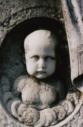 The Baby Faced Asylum Tombstone              Near the center of Cedar Hill Cemetery is a large tombstone with a 3-D image of a baby's face carved on it. According to legend, if you stare at the baby's face for a while and then turn away, when you look back at the tombstone, the baby will be looking in a different direction. So make sure you take one last glance over your shoulder when you're walking away from this tombstone. Because you never know who, or what, might be watching you.