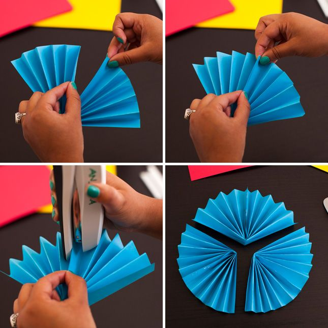 We're always gawking at all the creative backdrops we see at weddings, birthday parties, and other festive events that involve photo booths. One thing we've seen over and over again is the paper rosette backdrop. It's basically like making a whole bunch of paper fans, stapling them together, and attaching them to the wall. It's one DIY basic we're more than happy to teach you how to do! Read on to see just how simple it is.