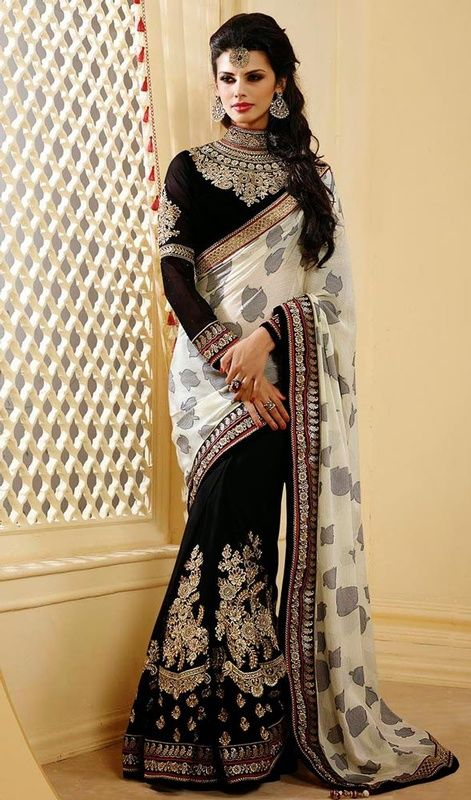 Create a zing factor dressed in this black and off white chiffon full sleeves embroidered half n half sari. The lace, moti, resham and stones work appears to be chic and fantastic for any party.  #AlluringGeorgetteDesignerSari