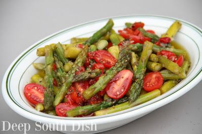 Cold Marinated Asparagus Salad - Fresh asparagus, cooked to crisp tender, then marinated in an oil and vinegar seasoned dressing with pimentos, and finished with sliced grape tomatoes.