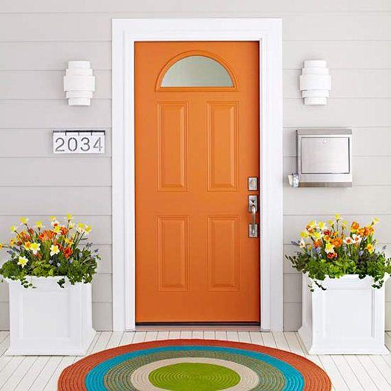Feel the happiness this orange door brings? Love the circular rug with it's pop of orange...