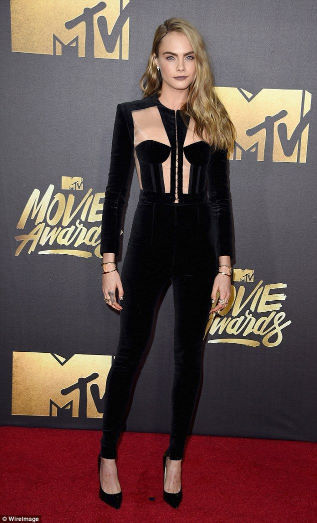 Meow: Cara Del seemed to be channeling Catwoman as she strolled the red carpet of the MTV Movie Awards on Saturday