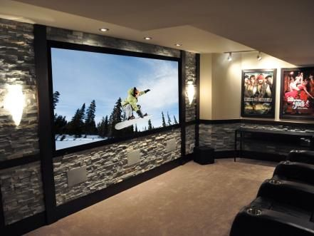 The goal for this client was to get the biggest screen and loudest sound possible for a small home theater space.