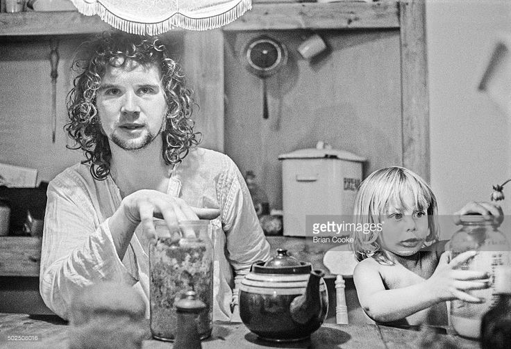 John Martyn pictured at home with his adopted son Wesley, in The Old Town, Hastings on September 8th 1971.