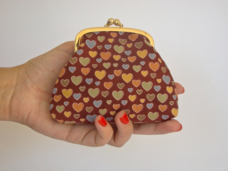 Handmade Framed Coin Pouch, jewelry pouch, pills purse, in a cinnamon hearts print. €12.00, via Etsy.