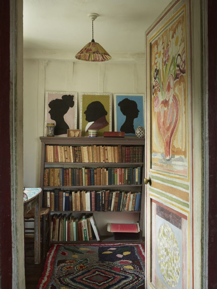 A door painted by Vanessa (and completed in 1918) leads out of Duncan's bedroom into his dressing room. On entering you are immediately faced with silhouette depictions of the Grant family. Duncan came to be part of the Bloomsbury Group through the introduction of his cousin and some time lover, Lytton Strachey.