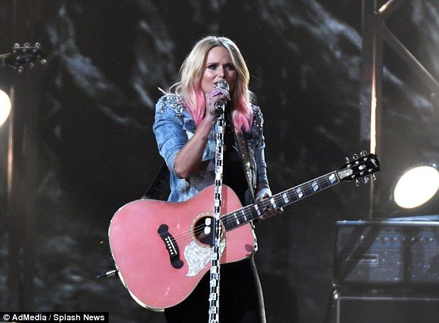On her game: Soon after Blake got on stage, Miranda performed a song in a denim jacket and...