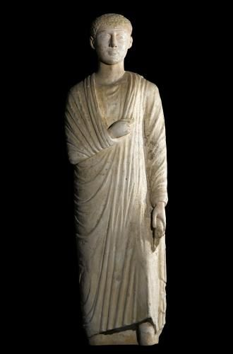 Statue of limestone with traces of gesso and pigment, of a standing man wearing a toga: Ancient Egyptian, from Oxyrhynchus (el-Bahnasa), Roman Period, 300 - 200 BC