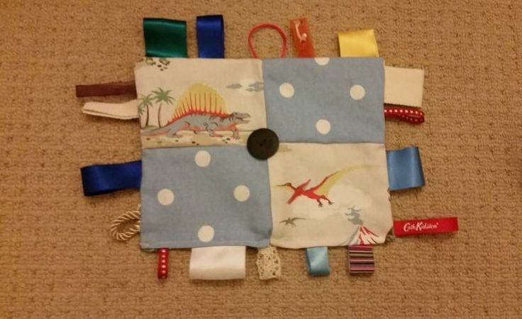 Baby/ child taggy blanket/ soother. Cath Kidston dinosaur & blue spot fabric