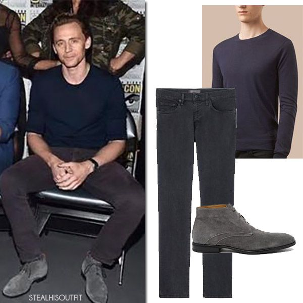 Tom Hiddleston in navy burberry sweater and grey jeans j brand