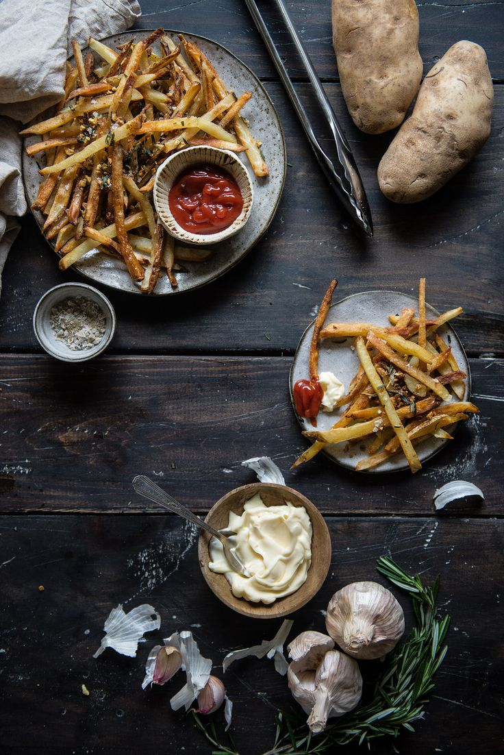 crispiest oven fries, with rosemary & garlic   two red bowls