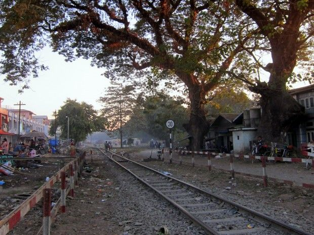 Misty, sun-spotted train tracks in downtown Myitkyina