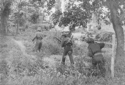 Juno Beach, North Shore Regiment on patrol