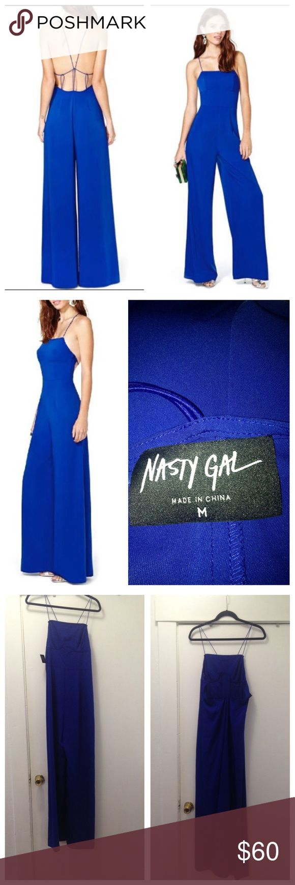 Nasty Gal NWT After midnight wide leg jumpsuit MED Super cute BRAND new with tag attached Nasty Gal After midnight wide leg cobalt blue jumpsuit size medium. Features strappy open back,side hidden zipper, wide legs  and spaghetti straps. So bright!! Size medium. This was purchased before nasty gal Sold!! So this is hard to find now!! Nasty Gal Pants Jumpsuits & Rompers