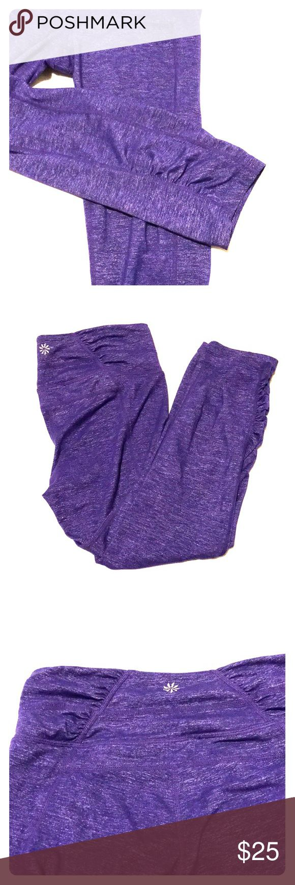 Cute Athleta tights! Dark bluish/purple heathered color with subtle metallic sheen (slimming!).  Cute gathered sections at back (either side of athleta symbol) and on lower part (hem) of the side panels.  3/4 length.  Medium rise.  Very comfortable.  Lots of stretch.  Very good used condition.  A few loose threads and mild wear but they look great!  The girl behind you in yoga won't notice a thing☺️.  Great for walking, running, yoga, spinning, barre, dance or just lounging around!  Style…
