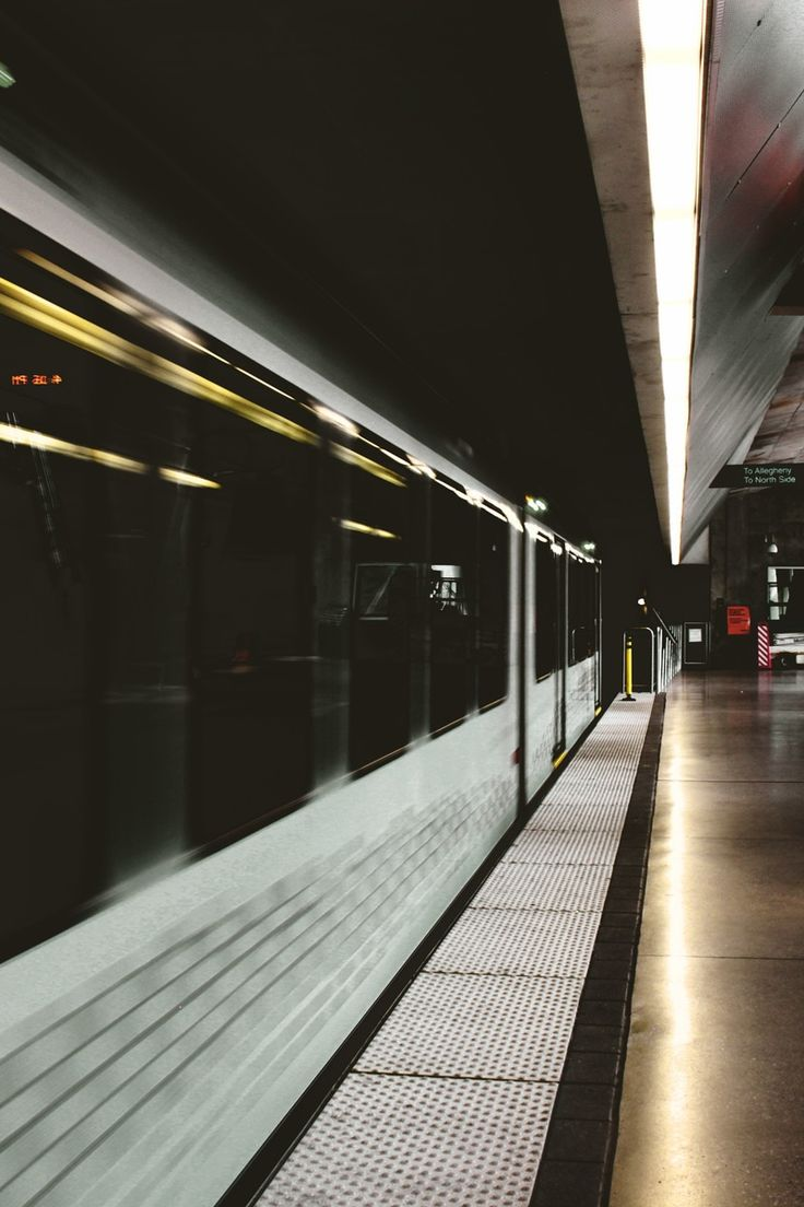 White and Black Subway Train Inside Station
