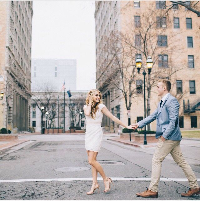 Great action shot in the city- engagement shoot