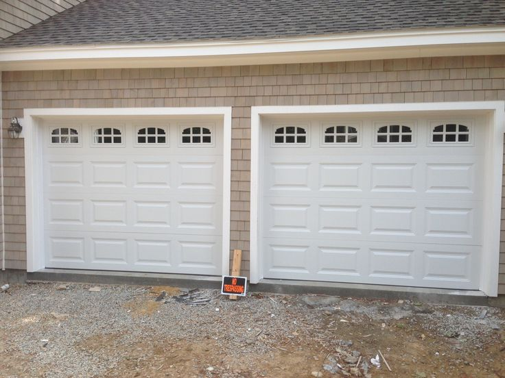 Haas Model 680 Steel Raised Panel Garage Doors In White With Cascade Glass.  Installed By