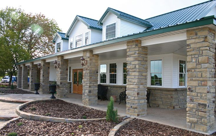 Kodiak steel homes meadowbrook model with brick column for Brick kit homes