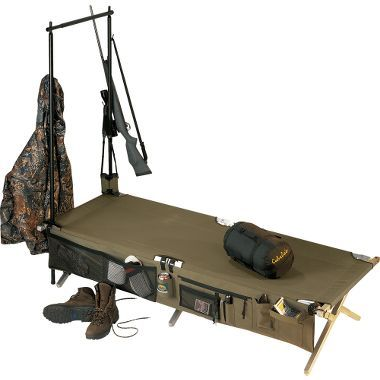 "Cabela's Heavy-Duty Army Cot 4-Pc. Combo: •Cot built to military specifications  •Convenient cot tree for hanging gear  •Nightstand keeps camp essentials close by  •Carry bag included  Sleeping area: 77""L x 28""W.  Weight capacity: 500-lb.  Included: •Heavy-Duty Army Cot.  •Cot-Side Nightstand™ and the Cot Tree™.  •Carrying bag."