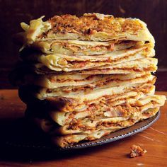 Algerian crepes: These thick, flaky crepes stuffed with a jammy tomato-based filling are a typical street snack in Algeria.