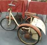 1950s triang tricycle. I had one of these. I remember trying to stuff the cat into the boot to take it for a ride.