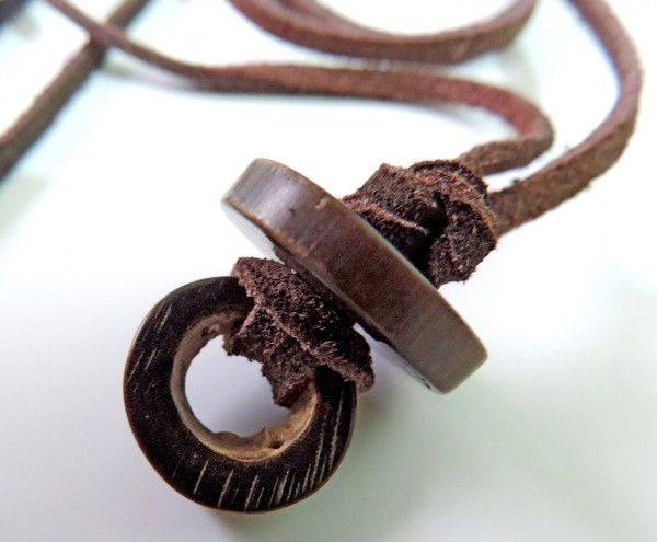 Pendant made of leather and bone
