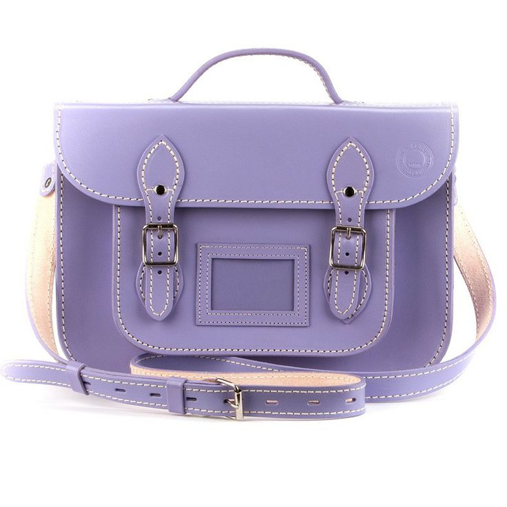 Lucky Lavender   13inch(34cm) - What a great colour- this reminds us of walking through fields of lavender on the Plot we grew up on! Lucky lavender is a beautiful pastel purple and this great medium sized 100% leather satchel looks great in this shade.  This 100% leather 13 inch satchel has a adjustable shoulder strap that's super reinforced for those 'on-the-go-moments'  as well as a top handle and our standard strong and sturdy silver coloured buckles with soft round edges so they are…