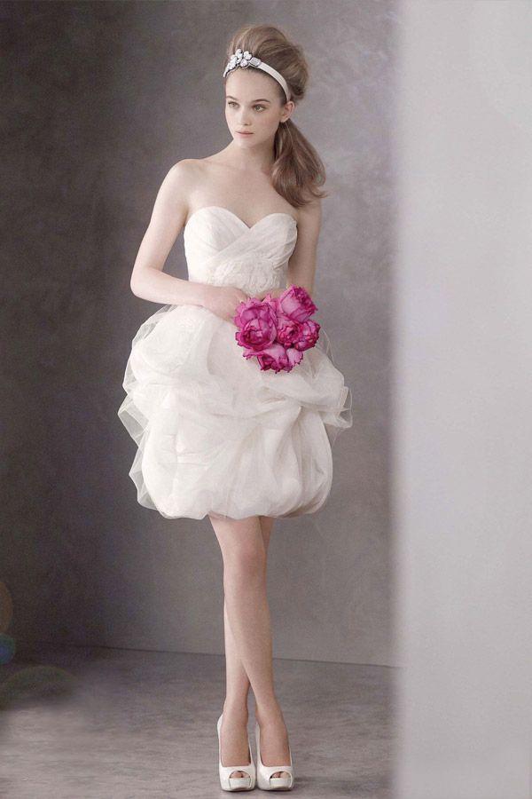 This dress is so unique..love that it's a short wedding dress