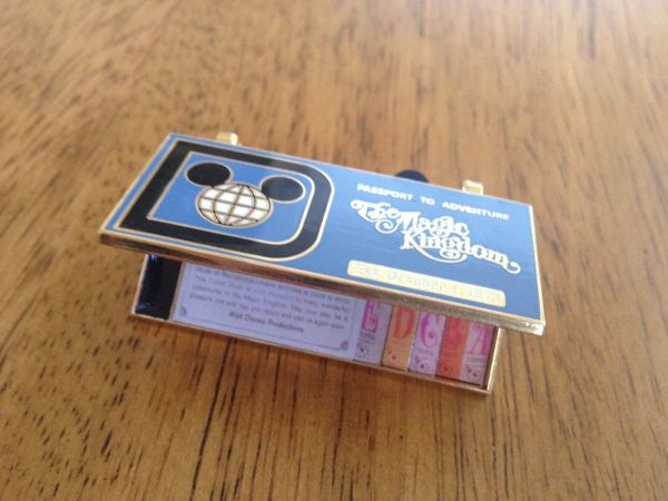 This collector pin features a reproduction of the Magic Kingdom ticket booklets.