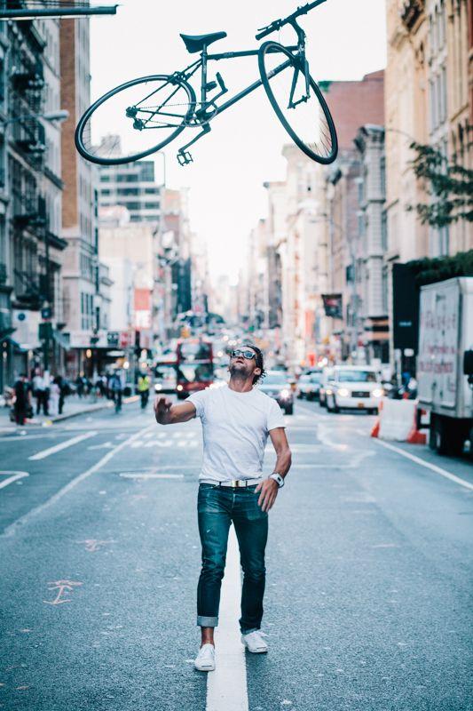 Casey Neistat tosses his bike. Image by Sam Polcer (New York Bike Style).