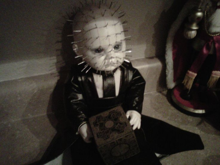 This doll creeps me out.  She will go great with my two-headed baby doll.  Website has 102 creative Halloween ideas.