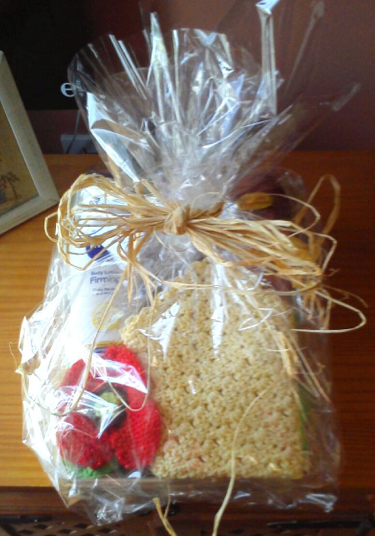 3 or 4 bathroom toiletries put together with a crocheted face cloth, a quickly knitted flower for colour & decoration, wrapped in cellophane and tied with raffia makes a great raffle prize :)