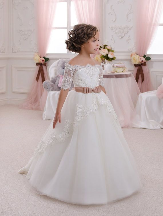 Beautiful ivory or white flower girl dress with multilayered skirt, corset with lace applique and rhinestones, zipper and lacing. Item material::